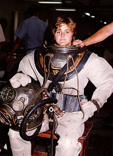 """What really got me into diving was that the standards for women were the same [as for men]. Women had to do the same number of sit-ups and push-ups. They had to climb up and down the dive ladders wearing the same 200-pound Mark V dive system."" Photo credit: NHHC"