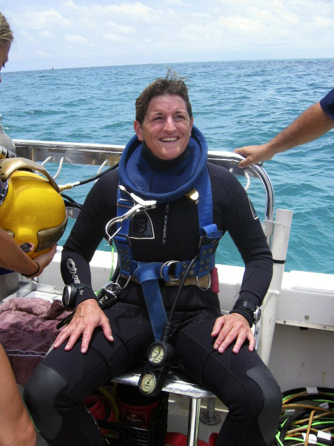 Karen Kohanowich, deputy director of the NOAA Undersea Research Program, getting ready for more training near the undersea lab Aquarius off the coast of Key Largo, Florida. Photo credit: NOAA (2006)